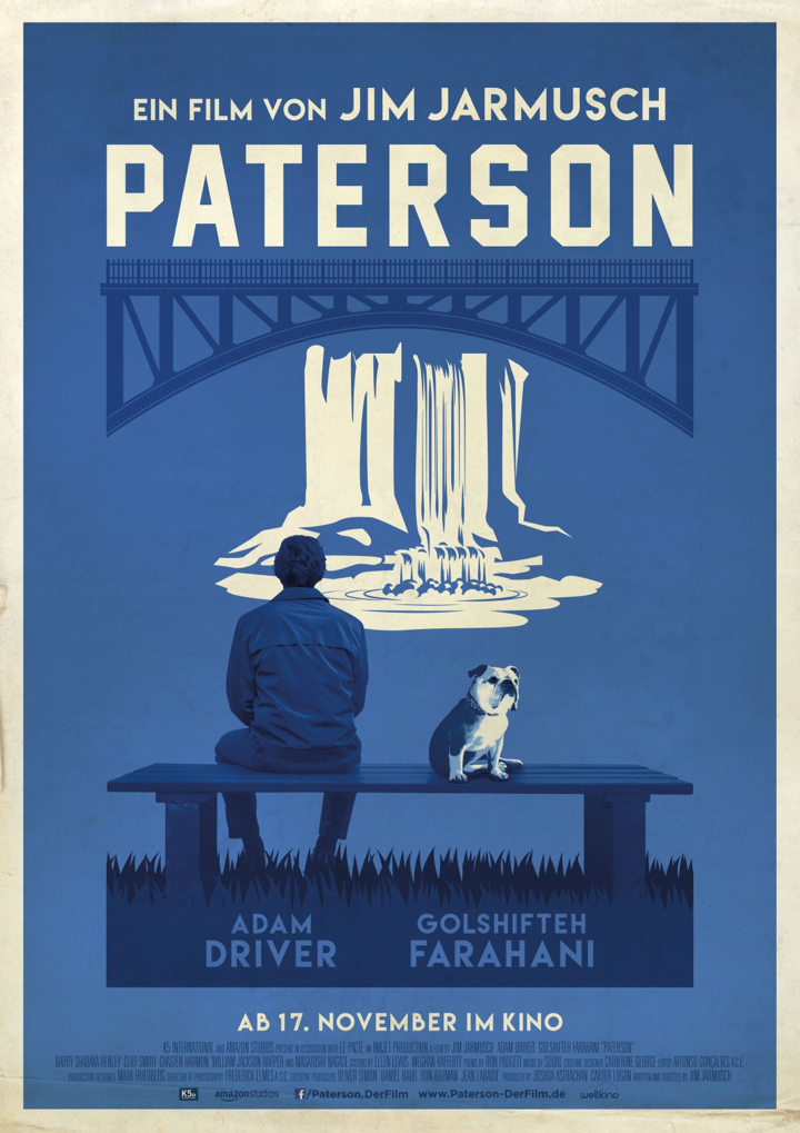 A blue and white illustrated poster showing Paterson sitting on a bench with his dog